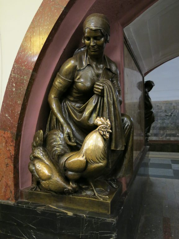 Bronze lady and chicken statue at Moscow Metro