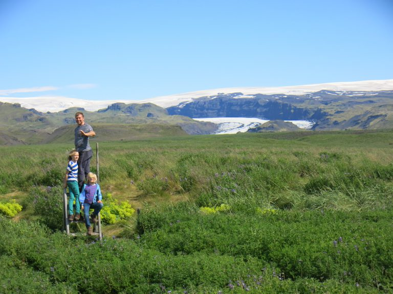 Green fields and glaciers in Iceland