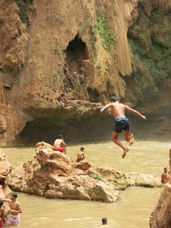Jumping man, Ouzoud falls, Morocco with kids